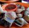 Cara membersihkan dan memasak siput gonggong